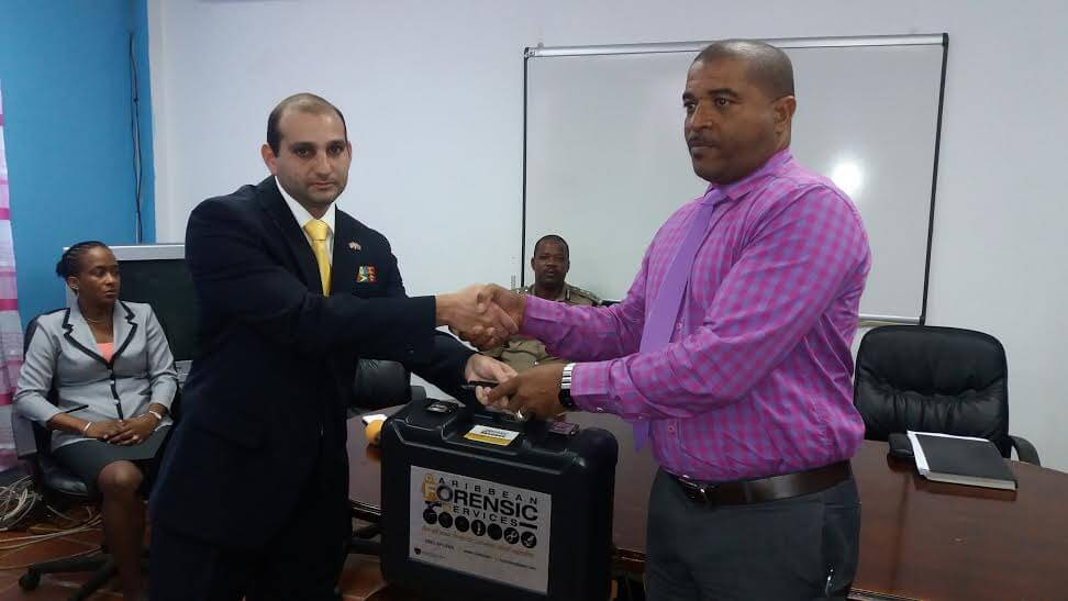 Forensic Latent Fingerprint Kit' was handed over to St. Lucia's Acting Commissioner of Police Errol Alexander and his crime scene experts by Dr. Maurice Aboud, Chief Forensic & Criminalistic Officer at ASSL and Lab Director at Caribbean Forensic Services Limited